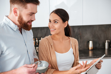 Close up couple in kitchen