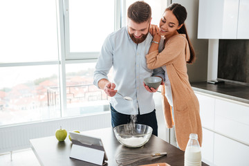 Young couple cooked in kitchen