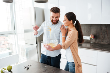 Attractive young couple cooking together in the kitchen