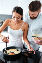 Attractive couple prepared pancake