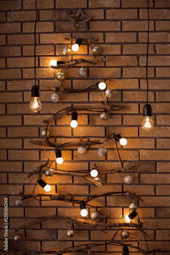 christmas brick new year holiday loft interior bulbs lights hanging down at the