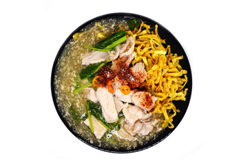 Crispy fried noodle pork with raadna sauce and top with thai chilli, One popular dish in Thailand.