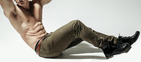 sexy muscular man athlete ytaining