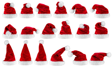 red white christmas santa hats luxury high quality plush row set collection isolated on white background / Weihnachtsmützen Nikolausmützen Reihe Set isoliert