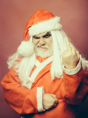 Christmas man showing middle finger