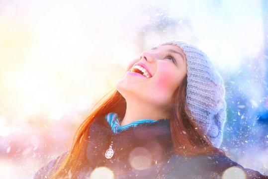 Winter girl portrait. Joyful teenage model girl having fun in winter park
