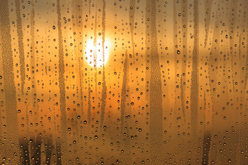 Rain on the glass at sunset