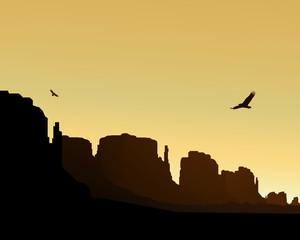 Western desert. Rocks. Flying eagles. Yellow sky.