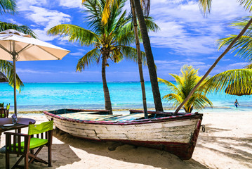 Fototapete - amazing tropical holidays. Beach restaurant with old boat. Mauritius island