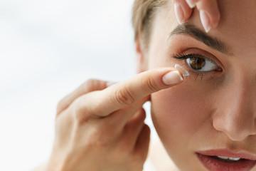 Vision Contact Lenses. Closeup With Beautiful Woman Face Wall mural