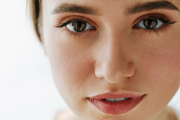 Closeup Of Beautiful Young Woman Face With Natural Makeup