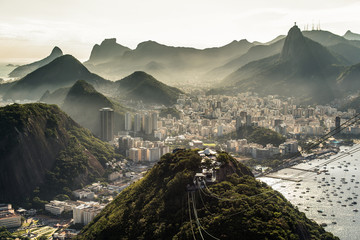 Fototapete - View of misty Rio de Janeiro city by sunset from the Sugarloaf Mountain