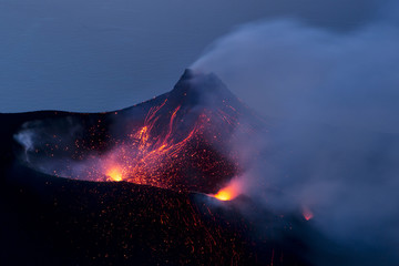 Stromboli vulcano. An explosion produces a fountain of lava and lapilli., Aeolian islands, Lipari islands,Sicily, Italy