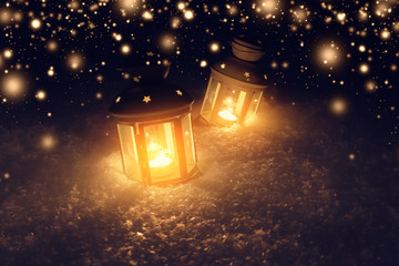 Decorative lights in snow at christmas night