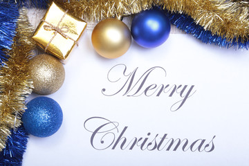 Text merry christmas on paper with blue balls and gift box