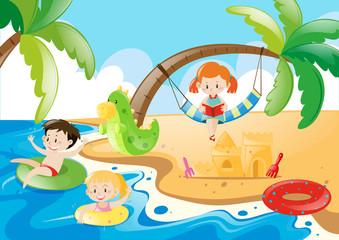 Three kids having fun at the beach