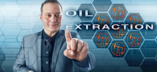 Smiling Businessman Activating OIL EXTRACTION