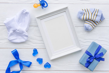 birth of child - blank picture frame on wooden background