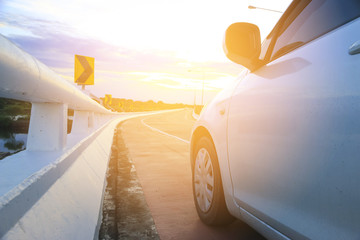 Stock Photo:.car on the road in sunset weather background.