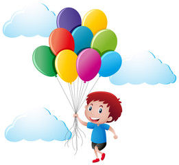 Boy holding colorful balloons