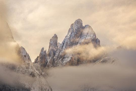 Cima Dodici mountain covered with clouds at sunrise, Bolzano, Italy