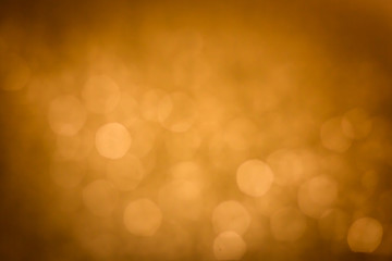 Abstract golden christmas bokeh lights background