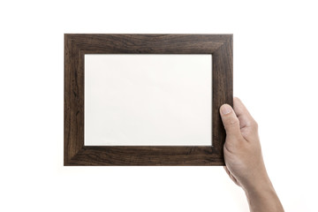 Two hands hold a photo(picture) wood frame isolated white.