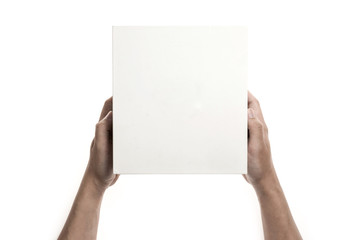 Two hands hold a empty(blank) white gift box isolated white