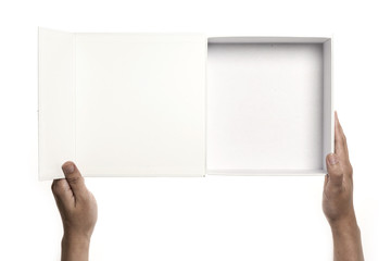 Two hands hold a empty(blank) white gift box opened isolated white