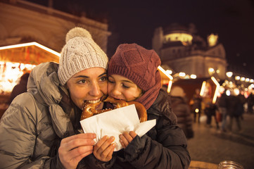 Family at the brezel market at christmas