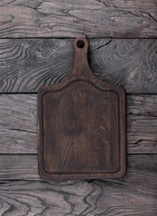 black cutting board on a black wooden table