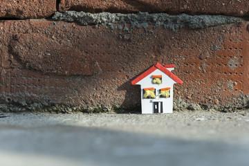 House miniature and brick wall