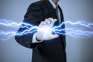 business person generating lightning from his hand
