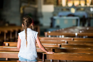 Child in beautiful old church in small italian city