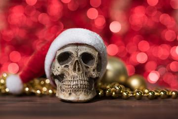 Santa claus skull and gold christmas ornament