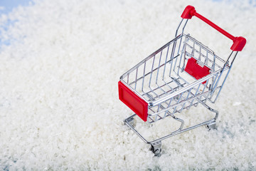 Shopping carts and Christmas decorations in the snow. Concept of