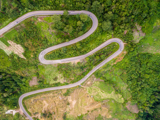 Aerial view of crooked path of road on the mountain, Shot from d