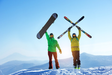 Skier and snowboarder mountain top Wall mural