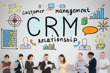 Businesspeople Holding Gadgets Near CRM Concept