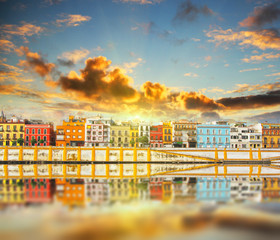 Magnificent Colorful panorama of Seville riverside of Guadalquivir at sunset, Spain