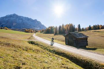 Woman mountain biking in Dolomites, South Tyrol, Italy