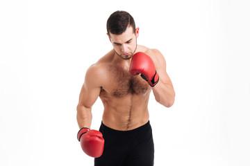 Naked boxer posing
