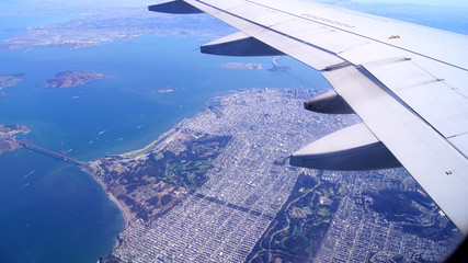 SAN FRANCISCO, USA - OCTOBER 4th, 2014: an aerial view of golden gate bridge and downtown sf, taken from a plane.