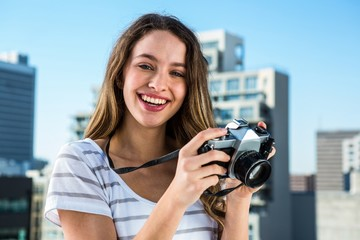 Young happy girl taking photos