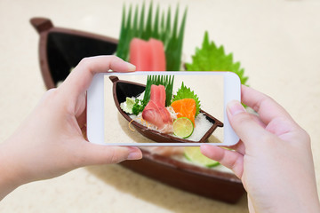 Taking photo of Japanese sashimi