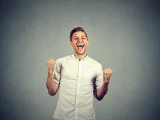 Happy successful business man winning fists pumped celebrating success
