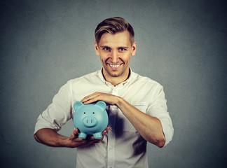 Portrait man with piggy bank