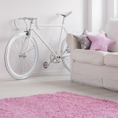 Old fashioned bicycle in teenage room