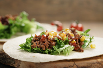 open tortilla with beef, frillice and corn, organic fastfood