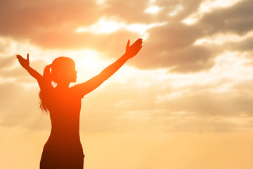 silhouette of woman pray